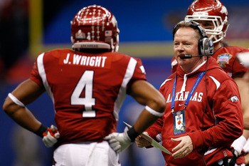 NEW ORLEANS, LA - JANUARY 04:  Head coach Bobby Petrino of the Arkansas Razorbacks looks over at Jarius Wright #4 against the Ohio State Buckeyes during the Allstate Sugar Bowl at the Louisiana Superdome on January 4, 2011 in New Orleans, Louisiana.  (Pho