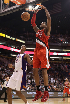 PHOENIX - DECEMBER 10:  LaMarcus Aldridge #12 of the Portland Trail Blazers slam dunks the ball over Channing Frye #8 of the Phoenix Suns during the NBA game at US Airways Center on December 10, 2010 in Phoenix, Arizona. The Trail Blazers defeated the Sun