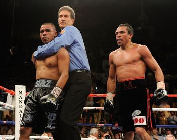 LAS VEGAS - JULY 31:  Referee Vik Drakulich separates Juan Diaz (L) and Juan Manuel Marquez (R) at the end of the final round of their bout at the Mandalay Bay Events Center July 31, 2010 in Las Vegas, Nevada. Marquez retained his WBA and WBO lightweight