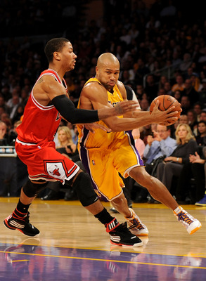 LOS ANGELES, CA - NOVEMBER 19:  Derek Fisher #2 of the Los Angeles Lakers drives to the basket against Derrick Rose #1 of the Chicago Bulls in the first quarter during the game on November 19, 2009 at Staples Center in Los Angeles, California.  NOTE TO US
