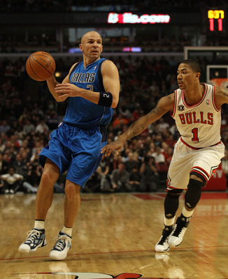 CHICAGO, IL - JANUARY 20: Jason Kidd #2 of the Dallas Mavericks looks to pass under pressure from Derrick Rose #1 of the Chicago Bulls at the United Center on January 20, 2011 in Chicago, Illinois. The Bulls defeated the Mavericks 82-77. NOTE TO USER: Use