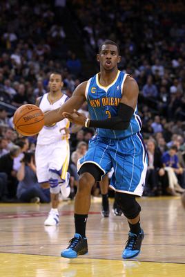 OAKLAND, CA - JANUARY 26:  Chris Paul #3 of the New Orleans Hornets passes the ball during their game against the Golden State Warriors at Oracle Arena on January 26, 2011 in Oakland, California.  NOTE TO USER: User expressly acknowledges and agrees that,