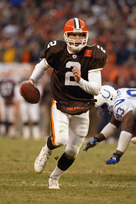 CLEVELAND - DECEMBER 15:  Quarterback Tim Couch #2 of the Cleveland Browns scrambles with the ball during the game against the Indianapolis Colts at Cleveland Browns Stadium on December 15, 2002 in Cleveland, Ohio. The Colts won the game 28-23. (Photo by
