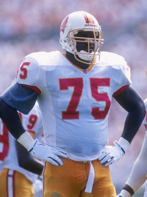 8 Oct 1995: Defensive lineman Eric Curry of the Tampa Bay Buccaneers looks on during a game against the Cincinnati Bengals at Tampa Stadium in Tampa, Florida. The Buccaneers won the game, 19-16.