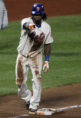 NEW YORK - AUGUST 14:  Jose Reyes #7 of the New York Mets celebrates his triple against the Philadelphia Phillies on August 14, 2010 at Citi Field in the Flushing neighborhood of the Queens borough of New York City.  (Photo by Jim McIsaac/Getty Images)