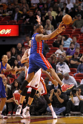 MIAMI, FL - JANUARY 28:  Tracy McGrady #1 of of the Detroit Pistons passes the ball during a game against the Miami Heat at American Airlines Arena on January 28, 2011 in Miami, Florida. NOTE TO USER: User expressly acknowledges and agrees that, by downlo