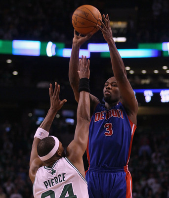 BOSTON, MA - JANUARY 19:  Rodney Stuckey #3 of the Detroit Pistons takes a shot over Paul Pierce #34 of the Boston Celtics on January 19, 2011 at the TD Garden in Boston, Massachusetts. The Celtics defeated the Pistons 86-82. NOTE TO USER: User expressly
