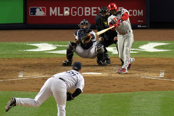 NEW YORK - NOVEMBER 04:  Jimmy Rollins #11 of the Philadelphia Phillies hits a sacrifice fly to drive in Carlos Ruiz #51 in the top of the third inning against Andy Pettitte #46 of the New York Yankees in Game Six of the 2009 MLB World Series at Yankee St