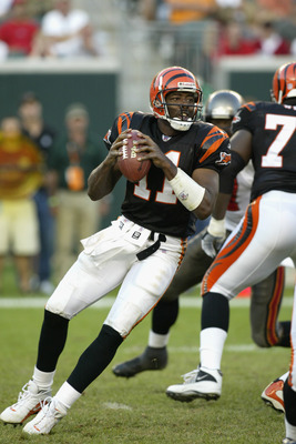 CINCINNATI - SEPTEMBER 29:  Quarterback Akili Smith #11 of the Cincinnati Bengals drops back to pass during the NFL game against the Tampa Bay Buccaneers on September 29, 2002 at Paul Brown Stadium in Cincinnati, Ohio.  The Buccaneers won 35-7. (Photo by
