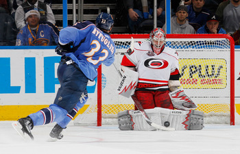 ATLANTA, GA - DECEMBER 16:  Goaltender Cam Ward #30 of the Carolina Hurricanes saves a shot by Dustin Byfuglien #33 of the Atlanta Thrashers during a shootout at Philips Arena on December 16, 2010 in Atlanta, Georgia.  (Photo by Kevin C. Cox/Getty Images)