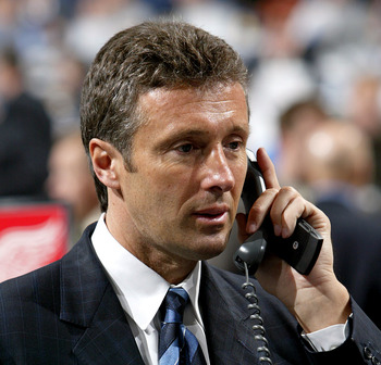 COLUMBUS, OH - JUNE 23:  General manager Doug Wilson of the San Jose Sharks talks on the telephone during the 2007 NHL Entry Draft at Nationwide Arena on June 23, 2007 in Columbus, Ohio.  (Photo by Dave Sandford/Getty Images)