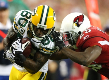 GLENDALE, AZ - JANUARY 10:  Donald Driver #80 of the Green Bay Packers is tackled by Bryant McFadden #25 of the Arizona Cardinals during the fourth quarter of the 2010 NFC wild-card playoff game at University of Phoenix Stadium on January 10, 2010 in Glen