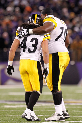 BALTIMORE, MD - DECEMBER 05:  Safety Troy Polamalu #43 of the Pittsburgh Steelers and teammate guard Trai Essex #79 celebrate defeating the Baltimore Ravens 13-10 at M&T Bank Stadium on December 5, 2010 in Baltimore, Maryland.  (Photo by Geoff Burke/Getty