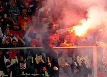 GENOA, ITALY - OCTOBER 12: Balaclava clad Serbian fan Ivan Bogdanov gestures towards riot police during the UEFA EURO 2012 Group C qualifier between Italy and Serbia at Luigi Ferraris Stadium on October 12, 2010 in Genoa, Italy. (Photo by Claudio Villa/Ge