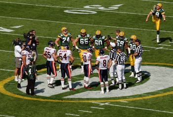 GREEN BAY, WI - SEPTEMBER 19:  A general view of the coin toss prior to the start of the game between the Green Bay Packers and Chicago Bears on September 19, 2004 at Lambeau Field in Green Bay, Wisconsin. The Bears defeated the Packers 21-10. (Photo by J