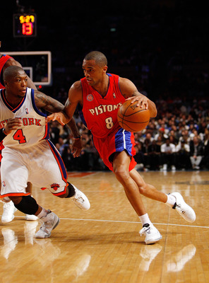 NEW YORK - MARCH 07: Juan Dixon #8 of the Detroit Pistons drives against Nate Robinson #4 of the New York Knicks on March 7, 2008 at Madison Square Garden in New York City. NOTE TO USER: User expressly acknowledges and agrees that, by downloading and/or u