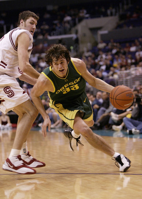 LOS ANGELES - MARCH 12:  Luke Jackson #33 of the Oregon Ducks drives to the basket past Matt Haryasz #52 of the Stanford Cardinal during the semifinals of the 2004 Pacific Life Pac-10 Tournament at Staples Center on March 12, 2004 in Los Angeles, Californ