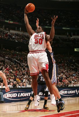 CHICAGO - JANUARY 13:  Michael Sweetney #50 of the Chicago Bulls grabs a rebound against the Memphis Grizzlies January 13, 2007 at the United Center in Chicago, Illinois. NOTE TO USER: User expressly acknowledges and agrees that, by downloading and or usi