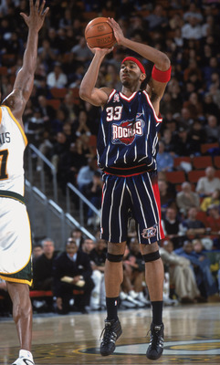 23 Nov 2001:  Eddie Griffen #33 of the Houston Rockets looks to pass the ball during the game against the Seattle SuperSonics at the Key Arena in Seattle, Washington. The Sonics defeated the Rockets 99-81. NOTE TO USER: User expressly acknowledges and agr