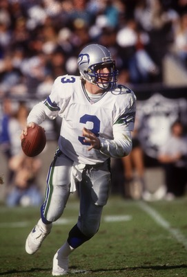 RICK MIRER, SEATTLE SEAHAWKS QUARTERBACK, SCRAMBLES LOOKS FOR AN OPEN RECEIVER DURING THE SEAHAWKS 23-27 LOSS TO THE RAIDERS IN LOS ANGELES. Mandatory Credit: Stephen Dunn/ALLSPORT