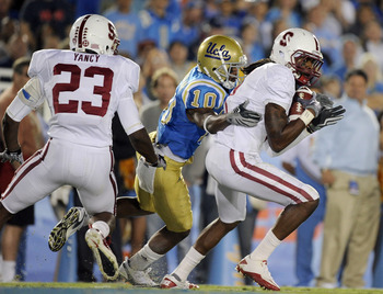 PASADENA, CA - SEPTEMBER 11:  Richard Sherman #9 of Stanford makes an interception in front of Ricky Marvray #10 of UCLA and Austin Yancy #23 of Stanford during the second quarter at Rose Bowl on September 11, 2010 in Pasadena, California.  (Photo by Harr