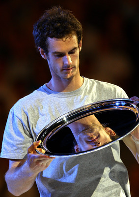MELBOURNE, AUSTRALIA - JANUARY 30:  Andy Murray of Great Britain poses with the runners up trophy after losing his men's final match against Novak Djokovic of Serbia during day fourteen of the 2011 Australian Open at Melbourne Park on January 30, 2011 in