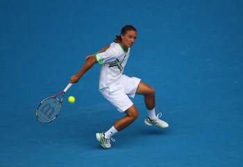MELBOURNE, AUSTRALIA - JANUARY 26:  Alexandr Dolgopolov of the Ukraine plays a backhand in his quarterfinal match against Andy Murray of Great Britain during day ten of the 2011 Australian Open at Melbourne Park on January 26, 2011 in Melbourne, Australia