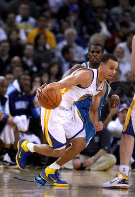OAKLAND, CA - JANUARY 26:  Stephen Curry #30 of the Golden State Warriors dribbles away from Chris Paul #3 of the New Orleans Hornets at Oracle Arena on January 26, 2011 in Oakland, California.  NOTE TO USER: User expressly acknowledges and agrees that, b