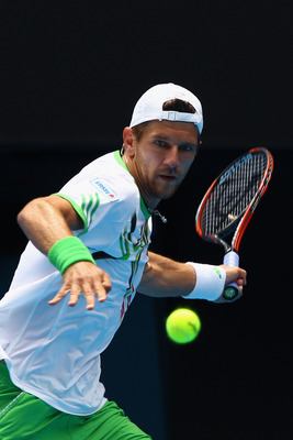 MELBOURNE, AUSTRALIA - JANUARY 24:  Jurgen Melzer of Austria plays a backhand in his fourth round match against during day eight of the 2011 Australian Open at Melbourne Park on January 24, 2011 in Melbourne, Australia.  (Photo by Quinn Rooney/Getty Image
