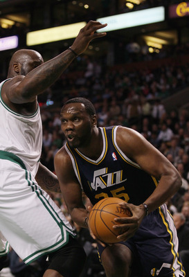 BOSTON, MA - JANUARY 21:  Al Jefferson #25 of the Utah Jazz tries to get around Shaquille O'Neal #36 of the Boston Celtics on January 21, 2011 at the TD Garden in Boston, Massachusetts.  NOTE TO USER: User expressly acknowledges and agrees that, by downlo