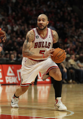CHICAGO, IL - JANUARY 28: Carlos Boozer #5 of the Chicago Bulls looks to pass against the Orlando Magic at the United Center on January 28, 2011 in Chicago, Illinois. The Bulls defeated the Magic 99-90. NOTE TO USER: User expressly acknowledges and agrees