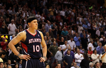 MIAMI, FL - JANUARY 18:  Mike Bibby #10 of the Atlanta Hawks looks on during a game against the Miami Heat at American Airlines Arena on January 18, 2011 in Miami, Florida. NOTE TO USER: User expressly acknowledges and agrees that, by downloading and/or u