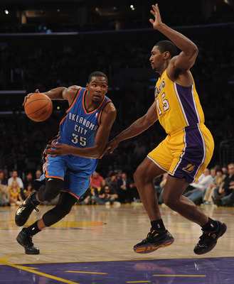 LOS ANGELES, CA - JANUARY 17:  Kevin Durant #35 of the Oklahoma City Thunder dribbles to the basket around Ron Artest #15 of the Los Angeles Lakers at the Staples Center on January 17, 2011 in Los Angeles, California.   NOTE TO USER: User expressly acknow