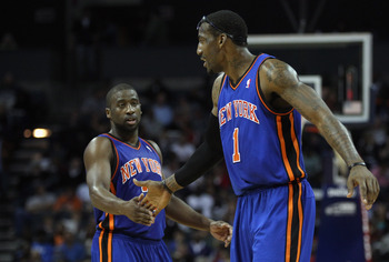 CHARLOTTE, NC - NOVEMBER 24:  Amare Stoudemire #1 of the New York Knicks and teammate Raymond Felton #2 react to a call during their game against the Charlotte Bobcats at Time Warner Cable Arena on November 24, 2010 in Charlotte, North Carolina.  NOTE TO