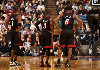 SACRAMENTO, CA - DECEMBER 11: Chris Bosh #1, Dwyane Wade #3 and LeBron James #6 of the Miami Heat stand on to the court during the shooting of a technical foul during their game against the Sacramento Kings at ARCO Arena on December 11, 2010 in Sacramento