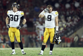 TUCSON, AZ - SEPTEMBER 18:  Cornerbacks Brett Greenwood #30 and Tyler Sash #9 of the Iowa Hawkeyes during the college football game against the Arizona Wildcats at Arizona Stadium on September 18, 2010 in Tucson, Arizona. The Wildcats defeated the Hawkeye