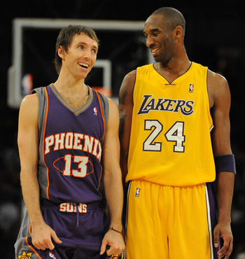 LOS ANGELES, CA - DECEMBER 10:  Steve Nash #13 of the Phoenix Suns laughs with Kobe Bryant #24 of the Los Angeles Lakers during the second half at the Staples Center on December, 10 2008 in Los Angeles, California.   NOTE TO USER: User expressly acknowled