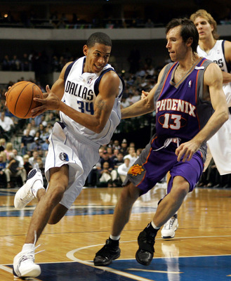 DALLAS - NOVEMBER 16:  Devin Harris #34 of the Dallas Mavericks moves the ball past Steve Nash #13 of the Phoenix Suns on November 16, 2004 at the American Airlines Center in Dallas, Texas.  NOTE TO USER: User expressly acknowledges and agrees that, by do