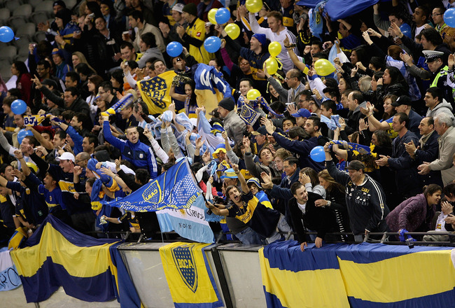 MELBOURNE, AUSTRALIA - JULY 16:  Boca Juniors fans celebrate during the pre-season International Friendly between Melbourne Victory and Argentina's Boca Juniors at Etihad Stadium on July 16, 2010 in Melbourne, Australia.  (Photo by Robert Prezioso/Getty I