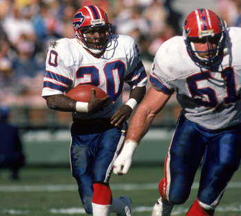 SAN DIEGO - DECEMBER 1:  Running back Joe Cribbs #20 of the Buffalo Bills follows his lead blocker Jim Ritcher #51 during a game against the San Diego Chargers at Jack Murphy Stadium on December 1, 1985 in San Diego, California.  The Chargers won 40-7.  (
