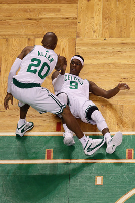 BOSTON - JUNE 13:  Rajon Rondo #9 of the Boston Celtics is helped up off the floor by teammate Ray Allen #20 during Game Five of the 2010 NBA Finals against the Los Angeles Lakers on June 13, 2010 at TD Garden in Boston, Massachusetts. NOTE TO USER: User
