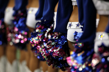 ARLINGTON, TX - OCTOBER 31:  A detail the Dallas Cowboys cheerleaders as they line up holding pom poms against the Jacksonville Jaguars at Cowboys Stadium on October 31, 2010 in Arlington, Texas.  (Photo by Ronald Martinez/Getty Images)