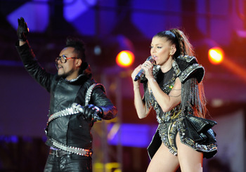 JOHANNESBURG, SOUTH AFRICA - JUNE 10: Taboo and Fergie of the Black eyed peas performs a song during the kick-off celebration concert for the 2010 FIFA World Cup at the Orlando Stadium on June 10, 2010 in Soweto, South Africa.  (Photo by Stuart Franklin/G