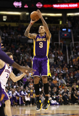 PHOENIX, AZ - JANUARY 05:  Matt Barnes #9 of the Los Angeles Lakers puts up a shot against the Phoenix Suns during the NBA game at US Airways Center on January 5, 2011 in Phoenix, Arizona. The Lakers defeated the Suns 99-95.  NOTE TO USER: User expressly