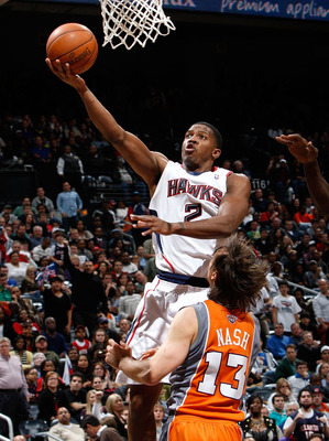ATLANTA - JANUARY 15:  Joe Johnson #2 of the Atlanta Hawks lays in a basket against Steve Nash #13 of the Phoenix Suns at Philips Arena on January 15, 2010 in Atlanta, Georgia.  NOTE TO USER: User expressly acknowledges and agrees that, by downloading and