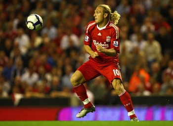 LIVERPOOL, ENGLAND - AUGUST 19:  Andriy Voronin of Liverpool in action during the Barclays Premier League match between Liverpool and Stoke City at Anfield on August 19, 2009 in Liverpool, England.  (Photo by Clive Brunskill/Getty Images)