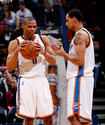 ATLANTA - JANUARY 18:  Russell Westbrook #0 and Thabo Sefolosha #2 of the Oklahoma City Thunder against the Atlanta Hawks at Philips Arena on January 18, 2010 in Atlanta, Georgia.  NOTE TO USER: User expressly acknowledges and agrees that, by downloading