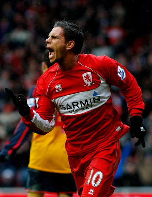 MIDDLESBROUGH, UNITED KINGDOM - DECEMBER 13:  Middlesbrough striker Jeremie Aliadiere celebrates after scoring the first Middlesbrough goal during the Premier League match between Middlesbrough and Arsenal at The Riverside Stadium on December 13, 2008 in