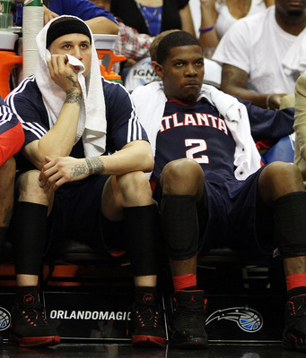ORLANDO, FL - MAY 04:  (L to R) Josh Smith #5, Mike Bibby #10 and Joe Johnson #2 of the Atlanta Hawks sit on the bench and watch the fourth quarter against the Orlando Magic in Game One of the Eastern Conference Semifinals during the 2010 NBA Playoffs at