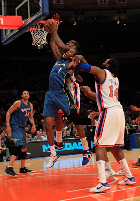 NEW YORK, NY - JANUARY 24: Amar'e Stoudemire #1 of the New York Knicks competes for a rebound against Nick Young #1 of the Washington Wizards at Madison Square Garden on January 24, 2011 in New York City. NOTE TO USER: User expressly acknowledges and agre